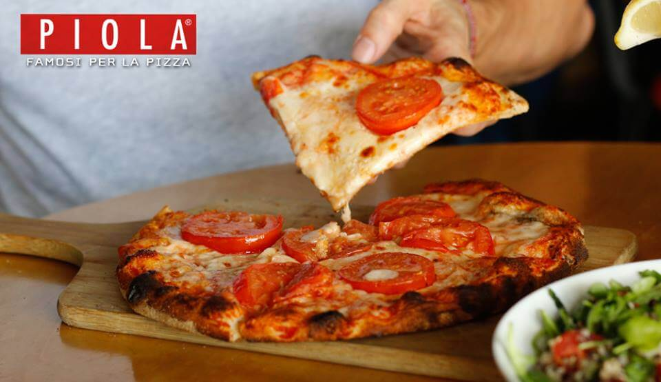 International Pizza Chain Piola Launches Vegan Cheese In Us