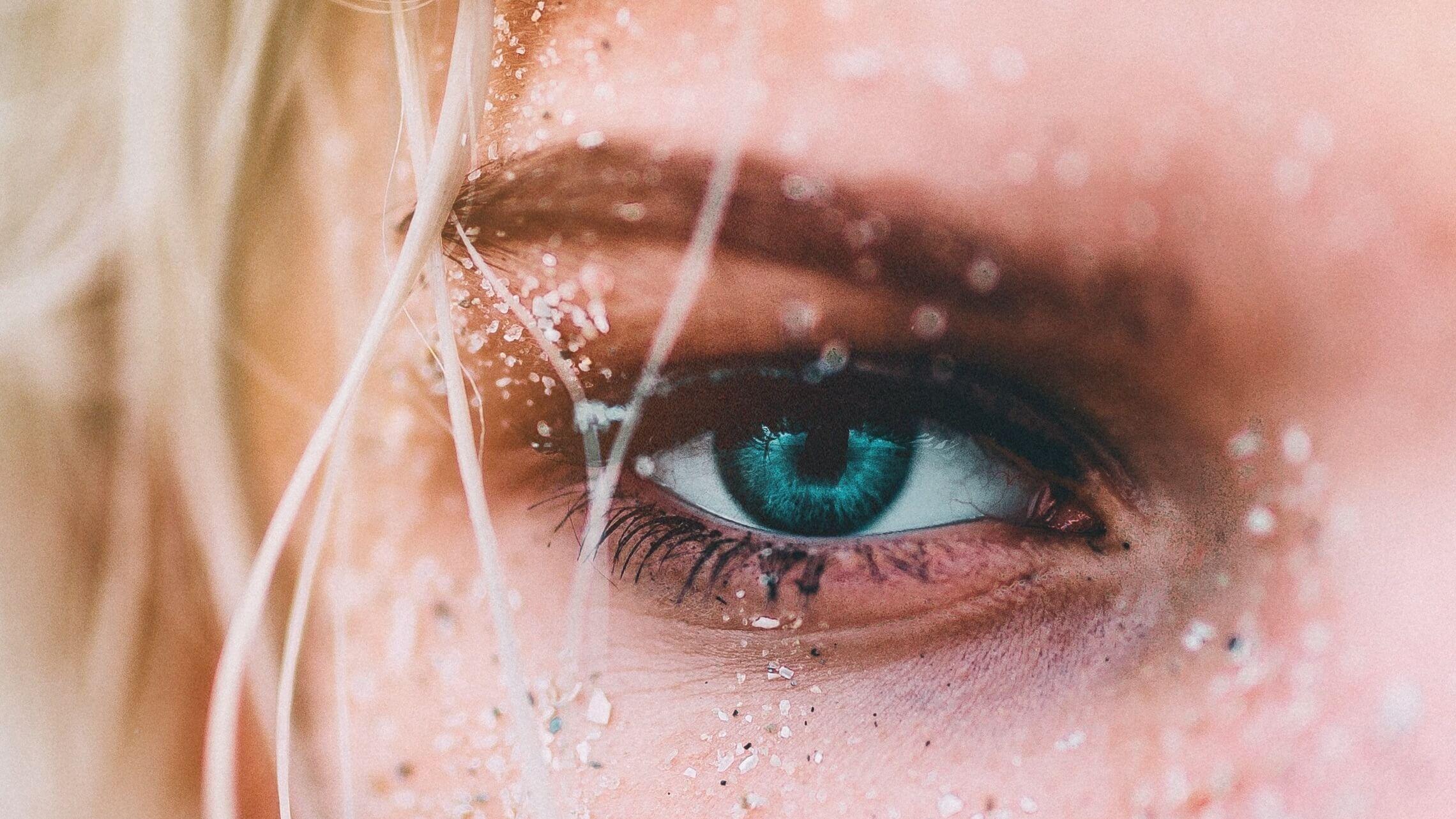 woman eye sand