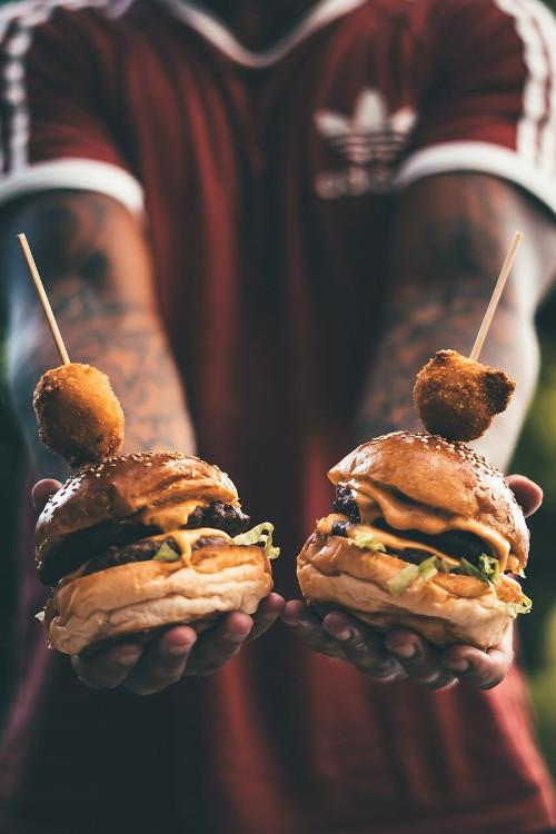man holding burgers