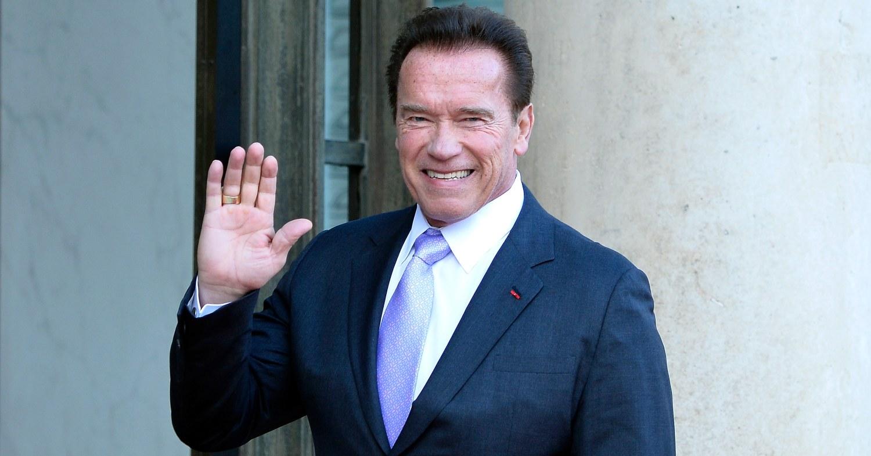 Arnold Schwarzenegger waving