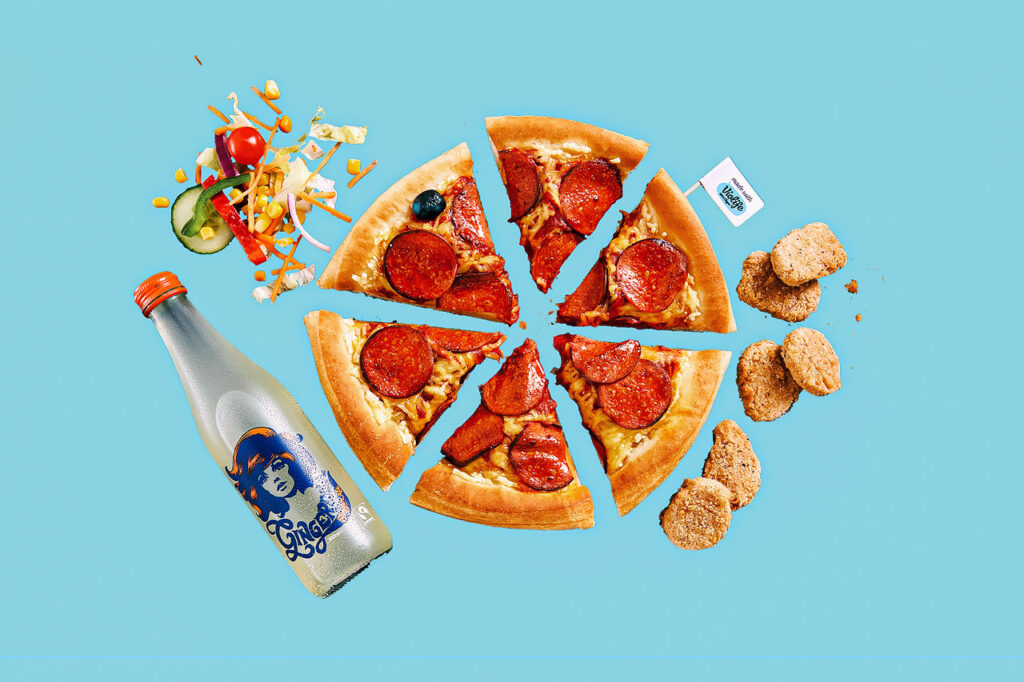 Collage of several Pizza Hut vegan menu items included in this guide, including pepperoni pizza, chicken nuggets, salad, and drink, on a pale blue background.