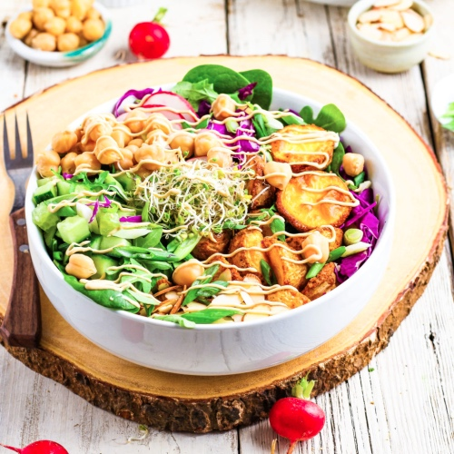 Simple and Satisfying Vegan Salad Bowl With Potatoes and Tahini Dressing