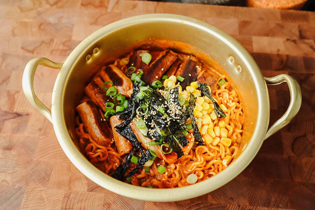 This spicy vegan Korean ramen features plant-based bacon and sausage. | Christina Ng/LIVEKINDLY