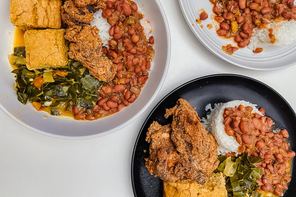 This vegan soul food meal features plant-based fried chicken, cornbread,