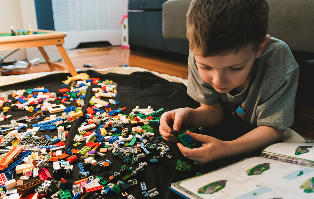 Child playing with plastic toys