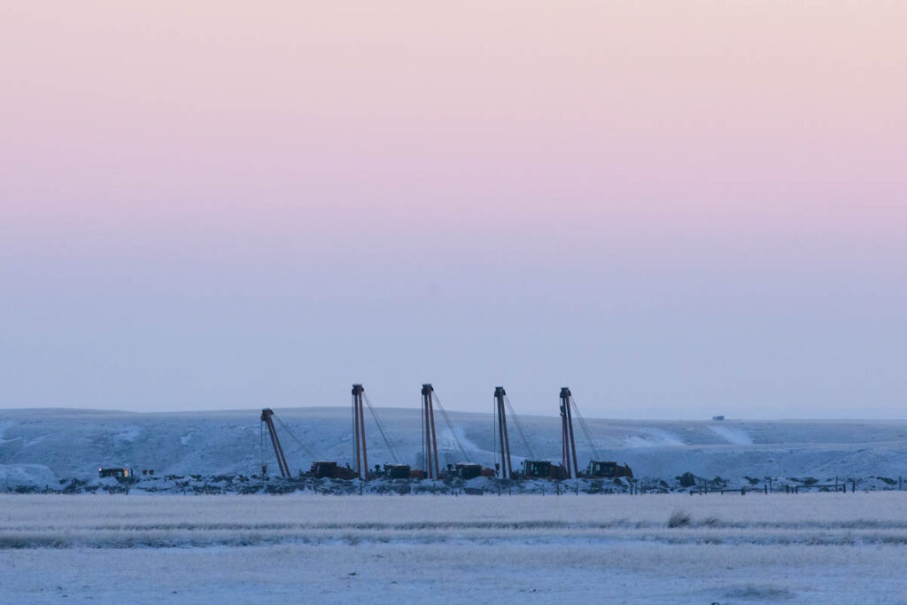 Photo of the machinery lining the Keystone pipeline's right of way in Alberta, Canada.