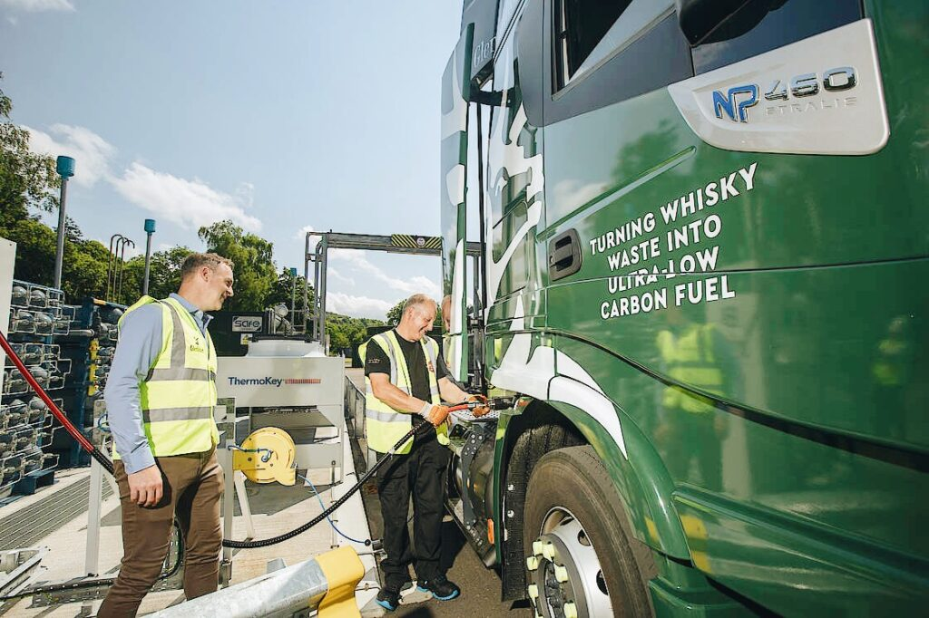 Photo of Glenfiddich workers fueling a sustainable truck.