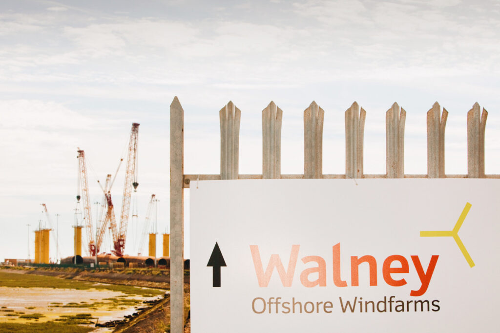 A photo of an offshore windfarm.