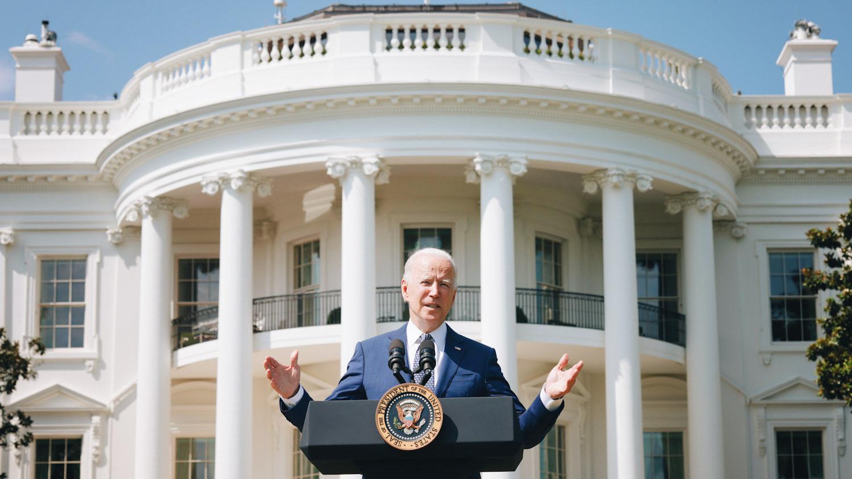 Photo of U.S. President Joe Biden speaking in front of the White House.