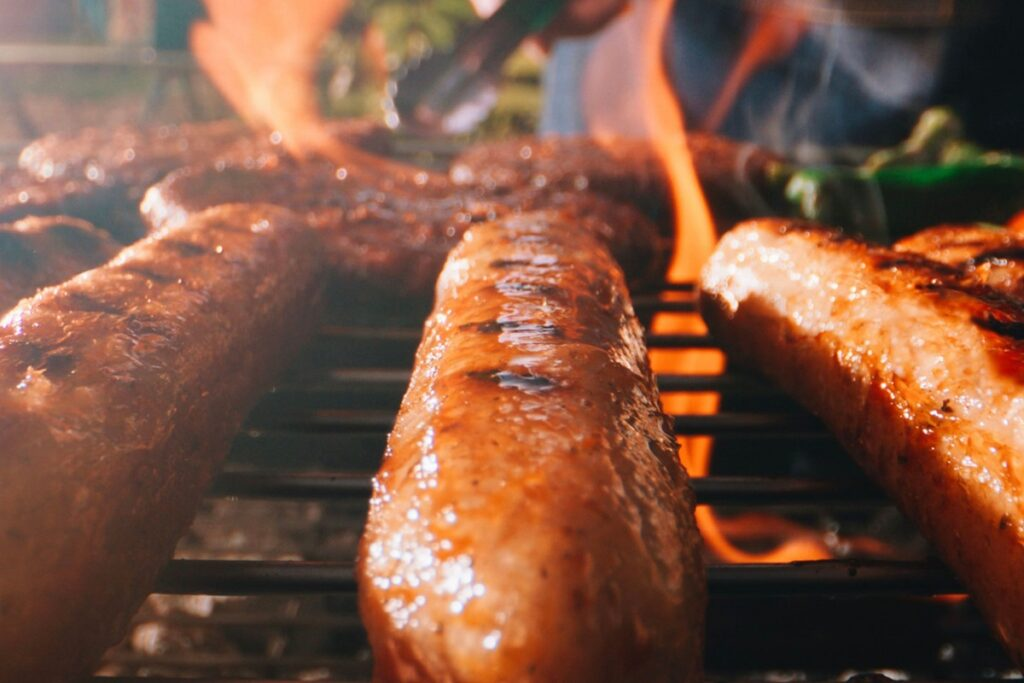LikeMeat vegan sausages on a grill