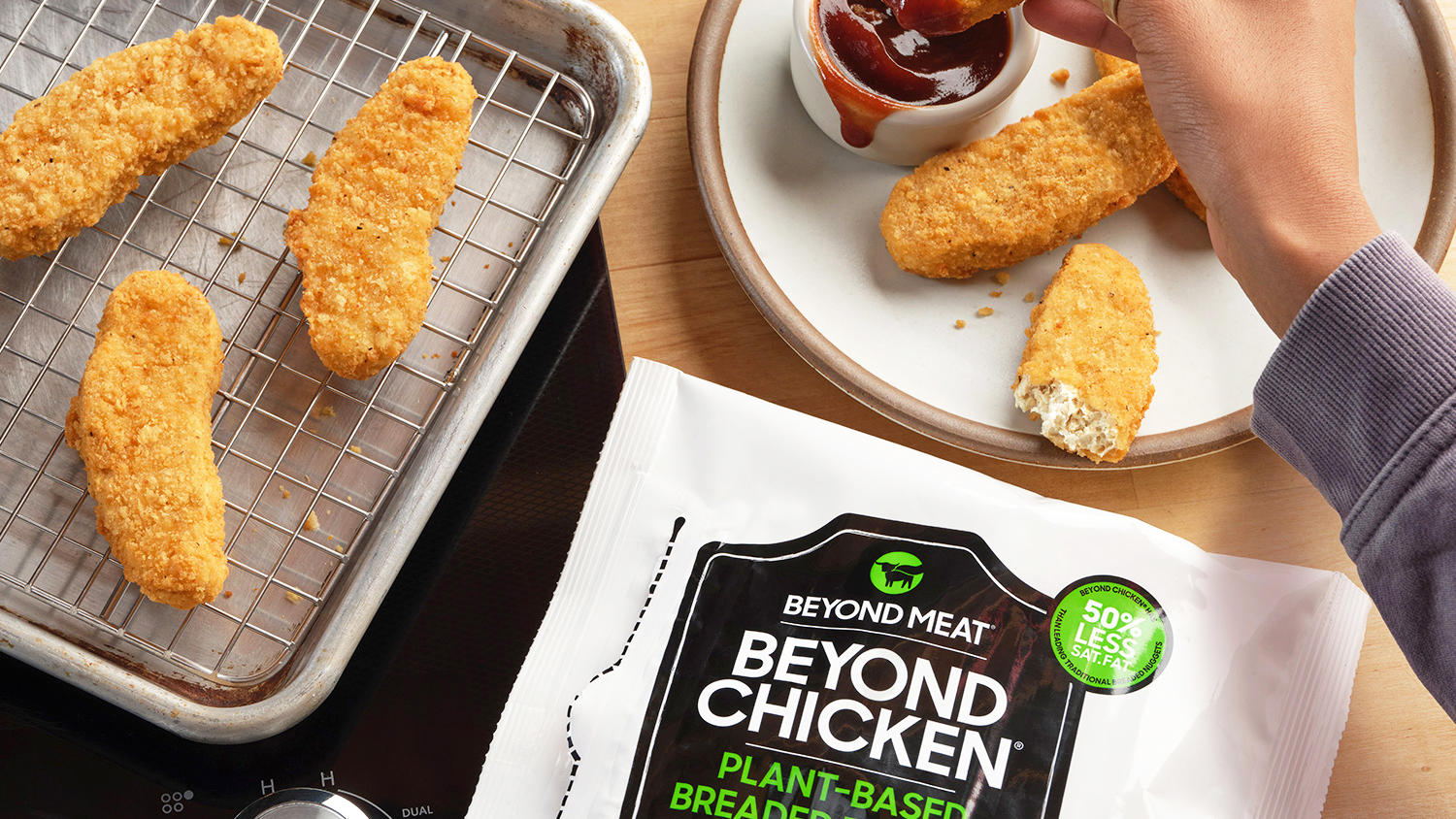 Beyond Meat's vegan chicken tenders on a plate and baking sheet