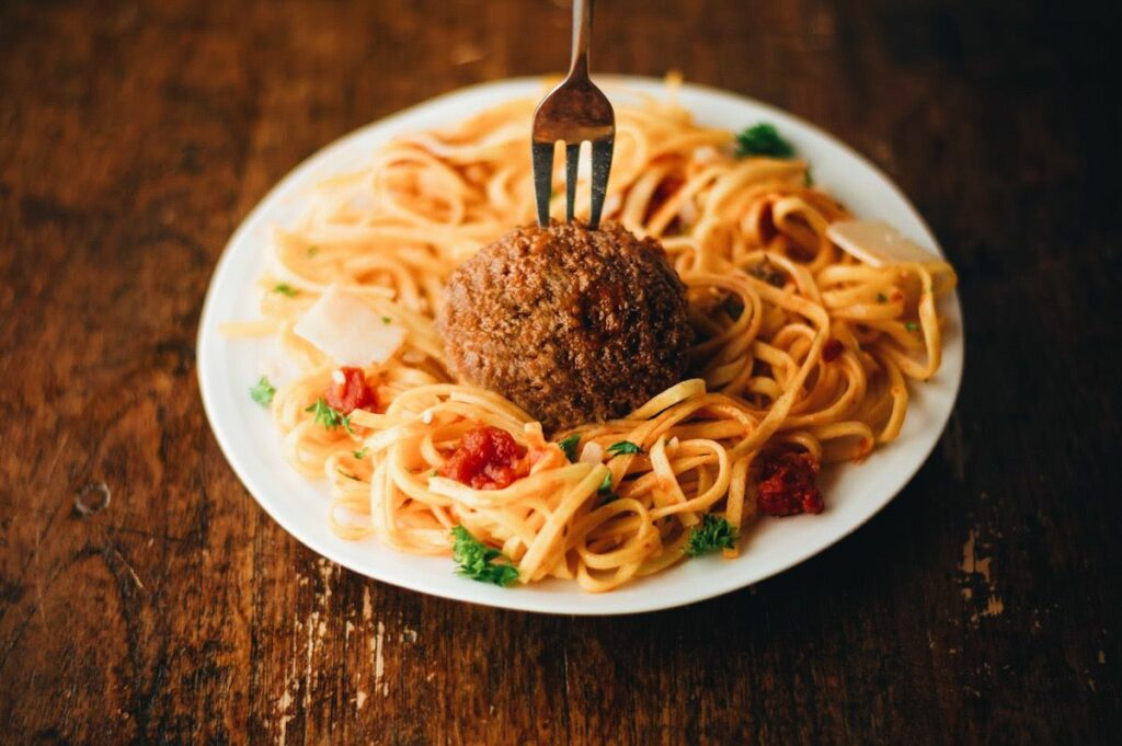 a cultured meat meatball with spaghetti