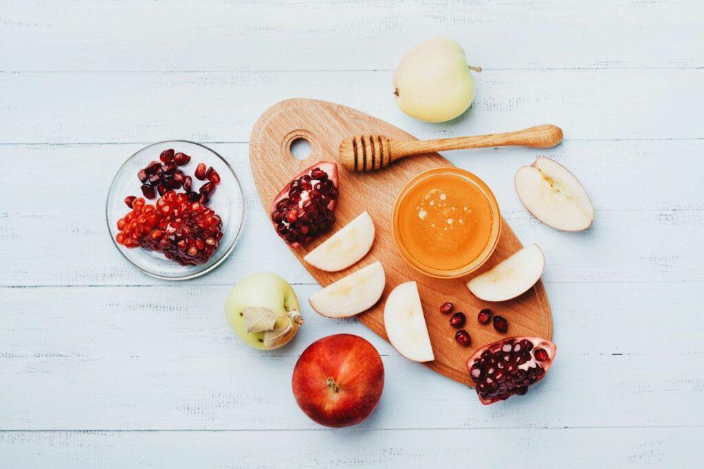 Traditional Rosh Hashanah foods: apples, pomegranates, and honey.
