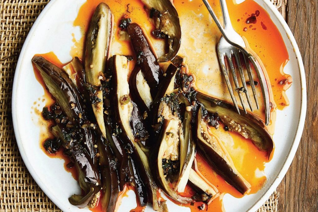 Photo shows thinly sliced eggplant served in green chili oil
