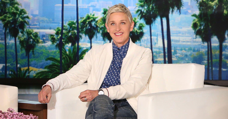 Photo showing Ellen DeGeneres wearing a white blazer and blue polka dot button-up shirt.