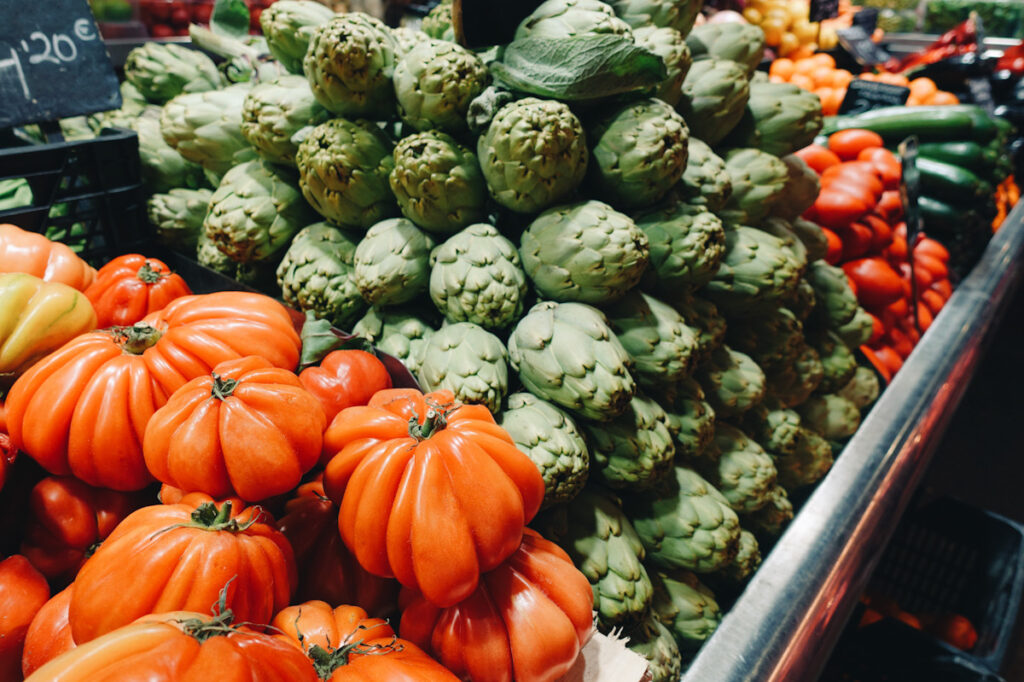 Photo shows a colorful display of vegetables at a market in Barcelona, Spain.